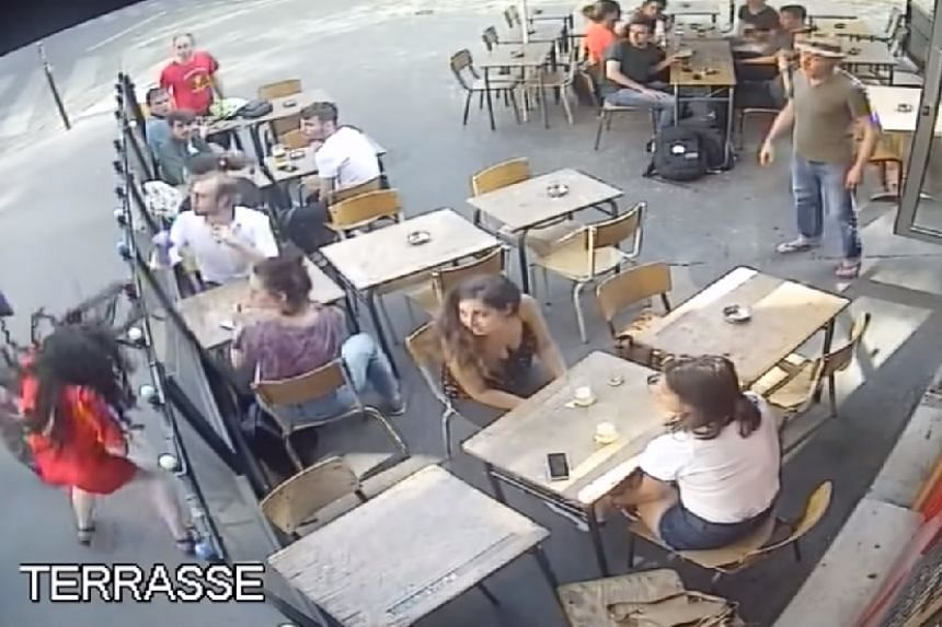 The man's attack on the woman (bottom left) is caught on a Paris cafe's camera.
