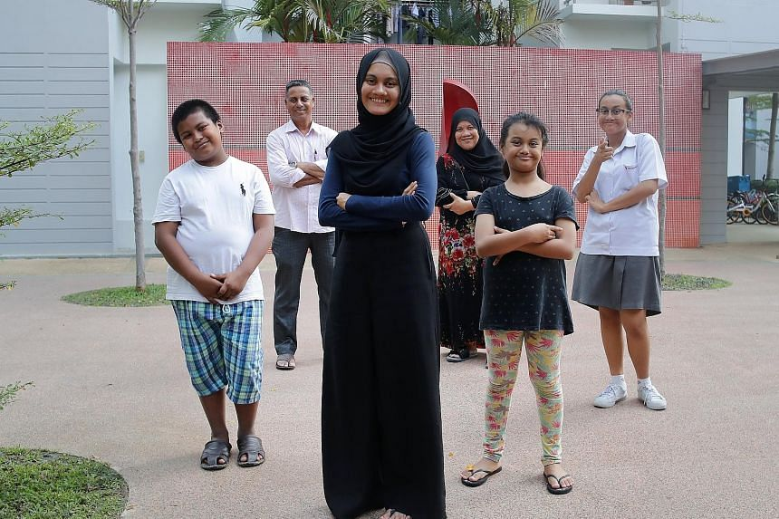 Ms Aliyah Fathin Sirajul Islam (centre) was a mother figure to (from left) her brother, Alman Safwan, 10, and sisters, Aliyah Tsara', nine, and Aliyah Maisarah, 13, while her parents, Mr Sirajul Islam and Madam Sapiah Haron, were busy rebuilding thei