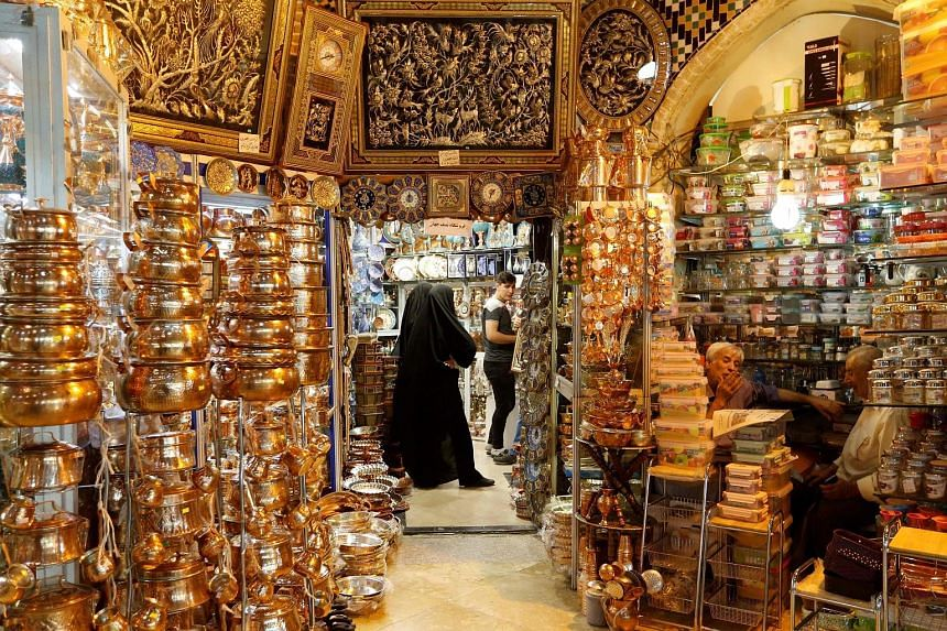 Teheran's Grand Bazaar. President Hassan Rouhani and some military commanders have threatened to disrupt oil shipments from Gulf countries through the Strait of Hormuz if Washington tries to strangle Teheran's oil exports.