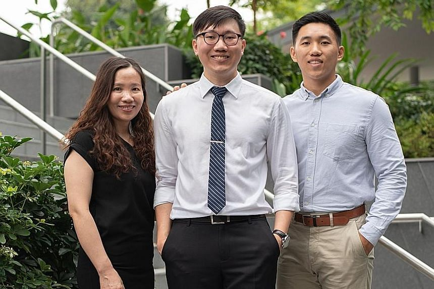 Social sciences student Ang Kheng Kiat (middle) with his mother Cheng Xiao Lan and younger brother Kheng Hian. Kheng Kiat, who comes from a relatively low-income family, had to partially fund his own studies.