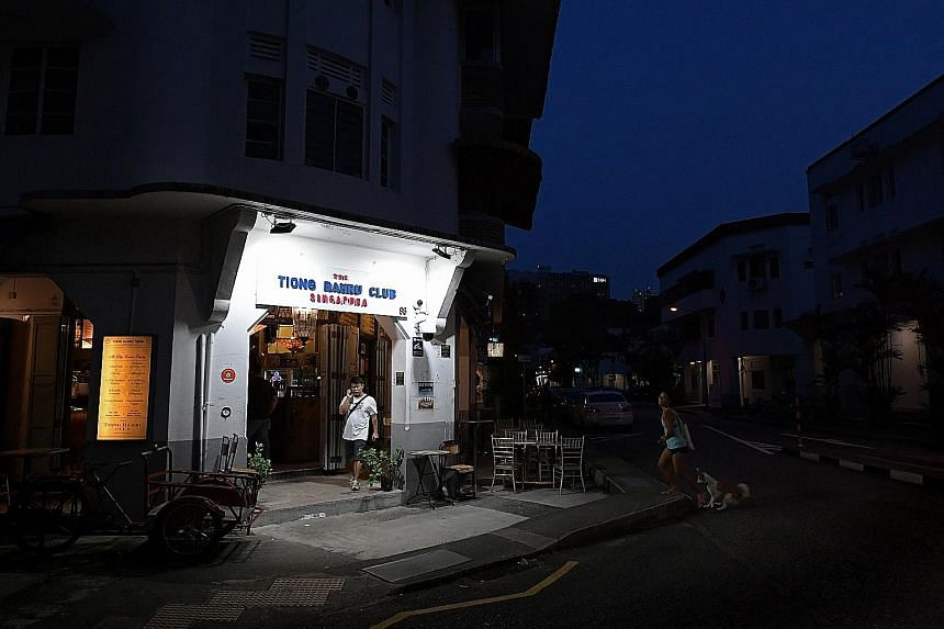 Tiong Bahru staple Por Kee Eating House (left) occupies one of the 28 units that were added on July 24 to the list of residential units in the estate rezoned for commercial use. A total of 120 units in Tiong Bahru are now zoned for commercial use, in