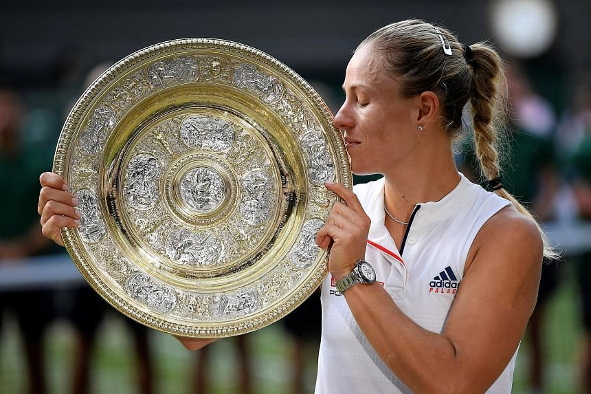 Angelique Kerber getting acquainted with the Venus Rosewater Dish, her prize for winning Wimbledon after overcoming Serena Williams in the final.