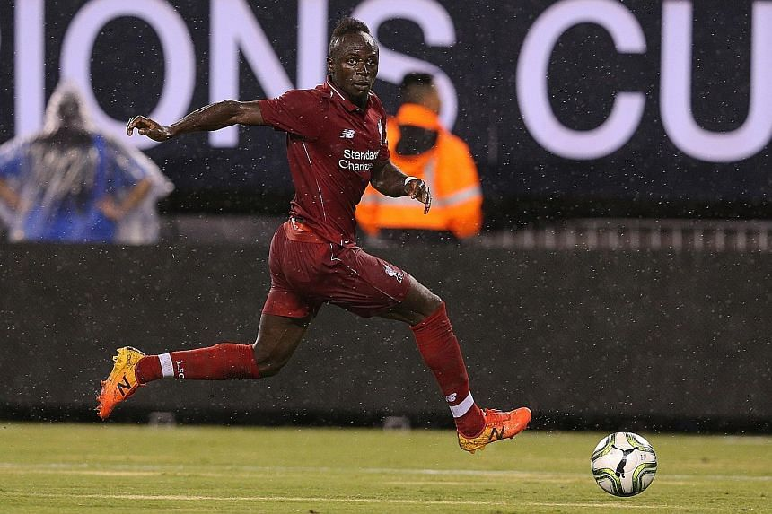 Liverpool's Sadio Mane in action against Manchester City during their ICC match last week. The winger still has three years remaining on his contract, but manager Jurgen Klopp is keen for him to follow Mohamed Salah and Roberto Firmino and finalise a