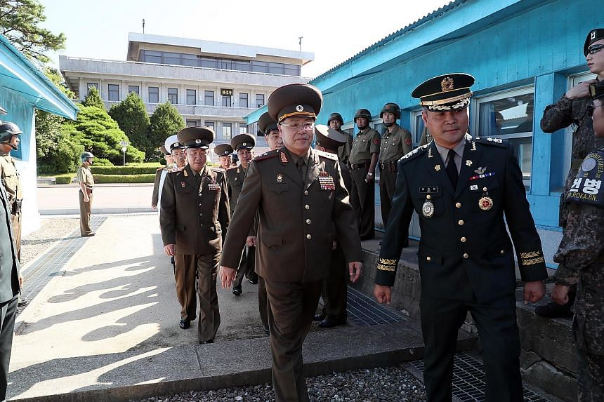 North Korea's Lieutenant-General An Ik San (right, wearing glasses) heading for the Peace House in the border truce village of Panmunjom in the South for the meeting with his South Korean counterpart yesterday. The talks produced no joint statement -