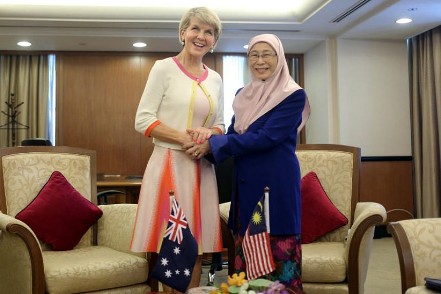 Malaysia's Deputy Prime Minister Wan Azizah Wan Ismail (right) with Australia's Foreign Minister Julie Bishop, who said that Australia had not received an extradition request for the officer who fled Malaysia in 2015.