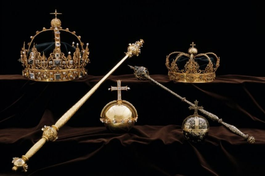 Two crowns and a jewelled orb (centre) were stolen from the Strangnas Cathedral, Swedish police said in a statement on July 31, 2018.