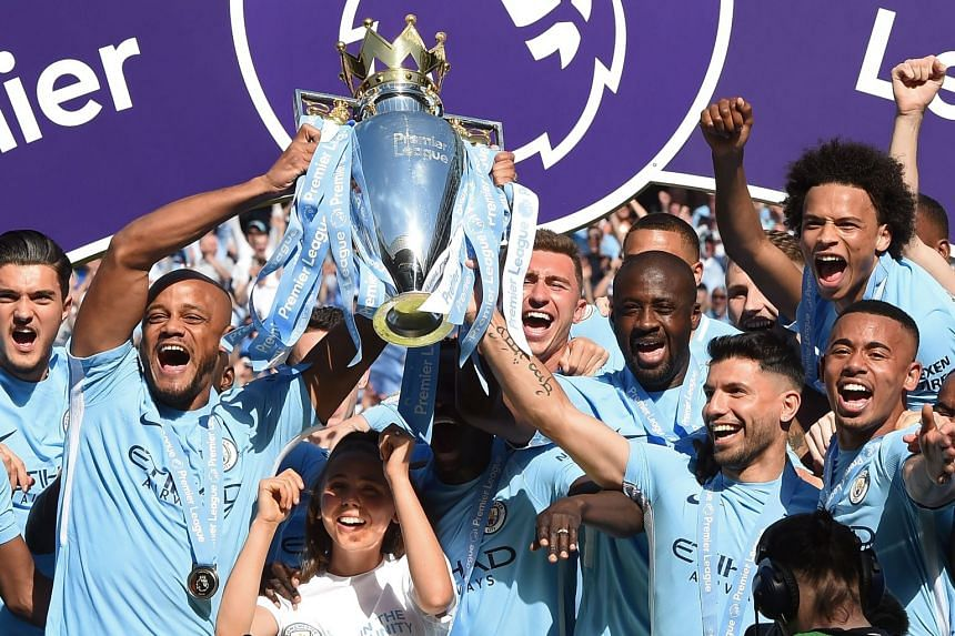 City players celebrating with the Premier League trophy in May 2018.