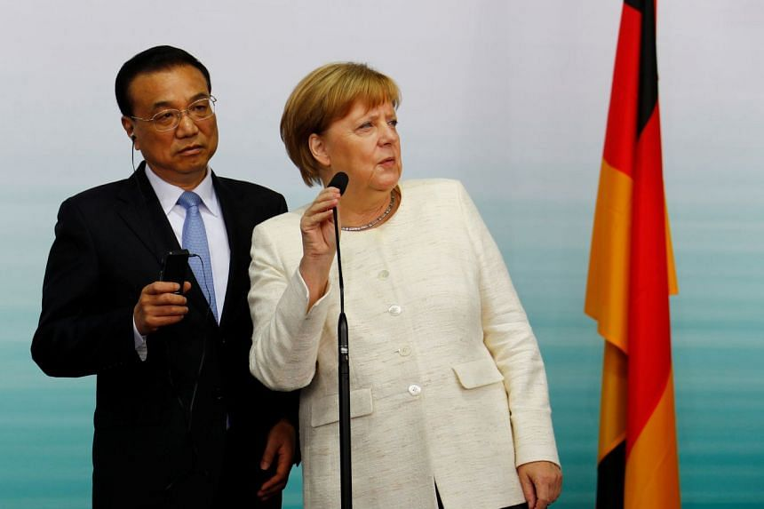 File photo showing Chinese Premier Li Keqiang (left) with Chancellor Angela Merkel, whose Cabinet's recent veto has indicated a toughening German stance toward investments from China.