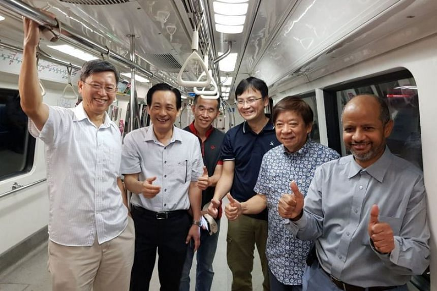 SMRT chief executive Neo Kian Hong (left), SMRT chairman Seah Moon Ming (second from left), Transport Minister Khaw Boon Wan (second from right) and representatives of LTA and SMRT observing a full-day signalling system trial, on April 29, 2018.