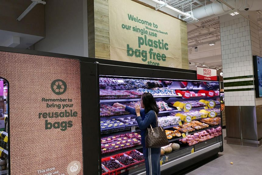 A shopper selects items inside a plastic bag-free Woolworths supermarket in Sydney, on June 15, 2018.