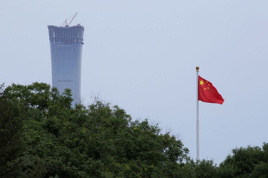 A Chinese flag flutters at Tiananmen Square in central Beijing, China, on June 8, 2018. China was involved in the drills as an observer in 2016.
