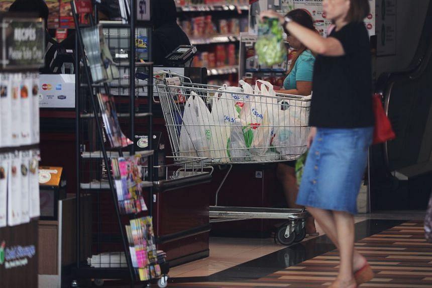 Singapore supermarkets give out 820 million plastic bags a year, or more than two million a day.