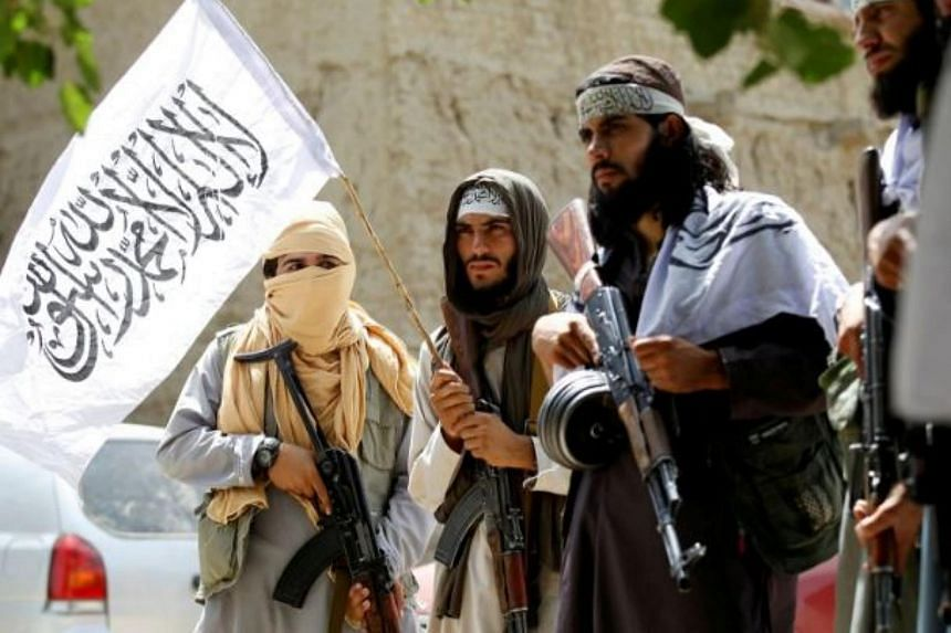 Taliban fighters celebrate a ceasefire in the Ghanikhel district of Nangahar province, Afghanistan, on June 16, 2018.