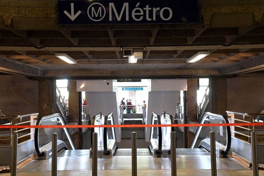 A picture taken at the railway station gate Montparnasse shows a red strap preventing access to the metro, in Paris, on July 28, 2018.