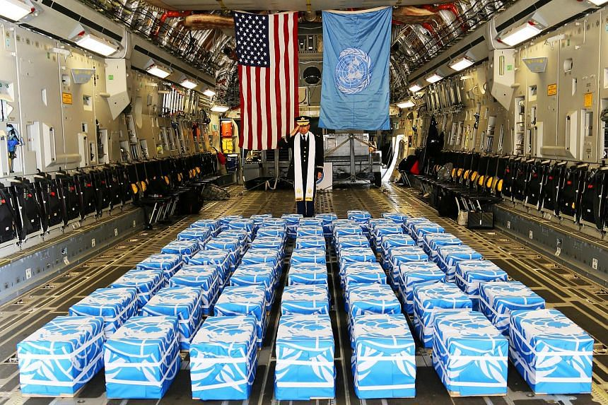 United Nations Command Chaplain US Army Col. Sam Lee performs a blessing of sacrifice and remembrance on the 55 boxes of remains thought to be of US soldiers killed in the Korean War, in South Korea, on July 27, 2018.
