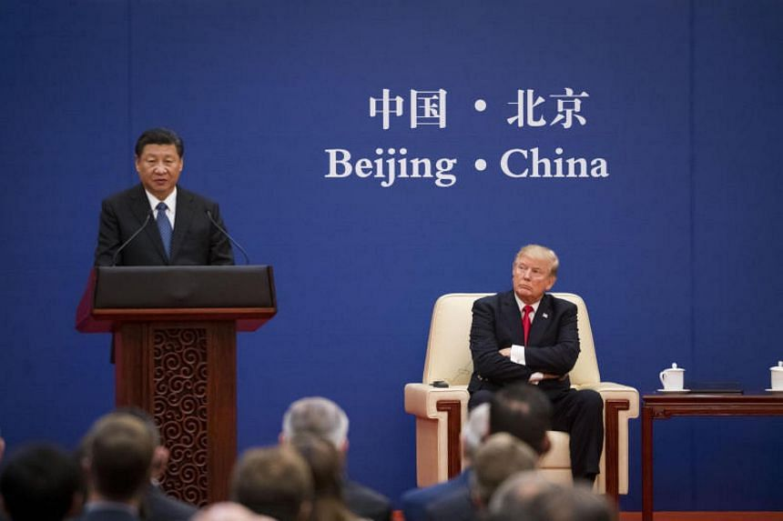 President Xi Jinping (left) of China with US President Donald Trump in Beijing, on Nov 9, 2017.