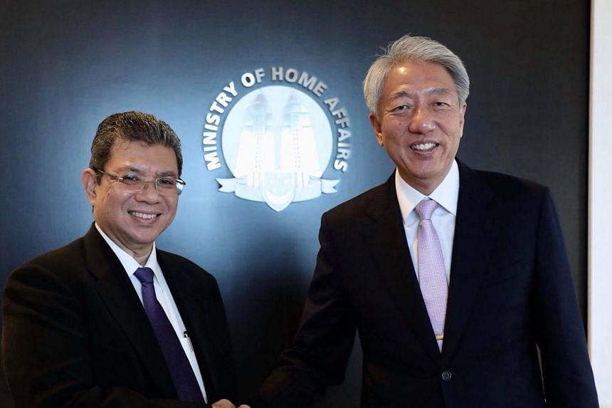 Visiting Malaysian Foreign Minister Saifuddin Abdullah meeting Deputy Prime Minister Teo Chee Hean yesterday. Datuk Saifuddin was in Singapore on a two-day introductory visit.