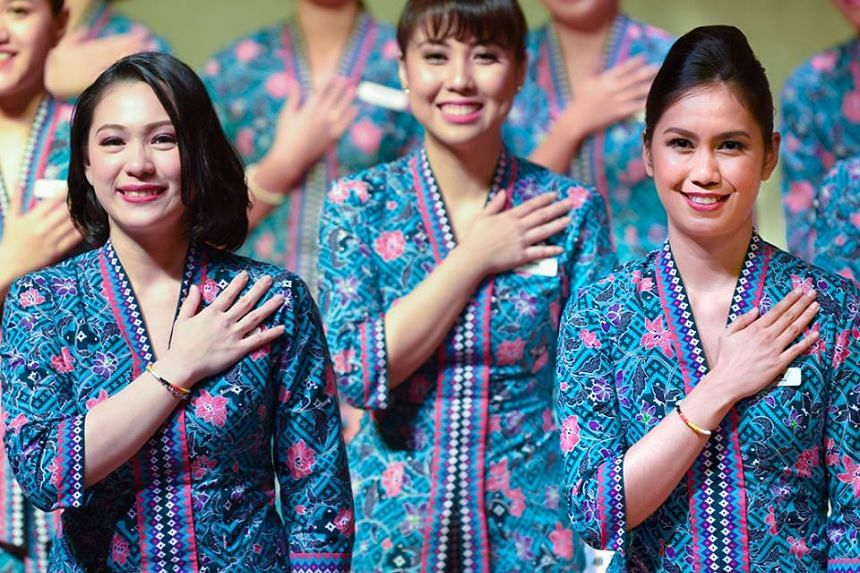 """Malaysia Airlines stewardesses. Malaysia's transport minister Anthony Loke has advised an Islamist lawmaker who complained that air stewardesses' uniforms are too revealing to just """"don't look""""."""