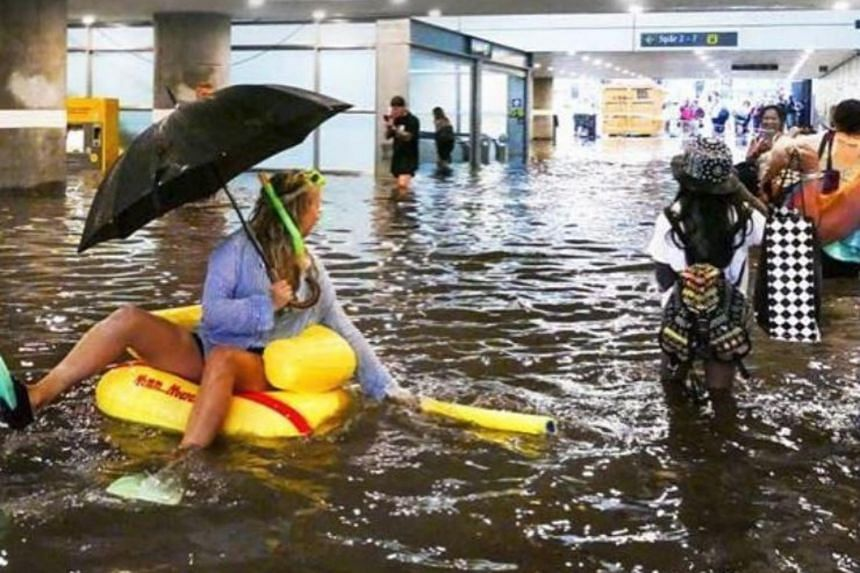Pictures on social media show commuters in full snorkelling gear, floats and swimsuits floating along the flooded underpass.