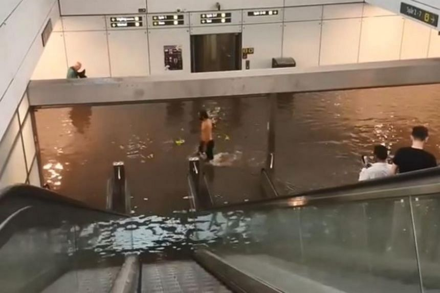 Security officers eventually asked commuters to leave the flooded station, concerned about the risk of electrocution.