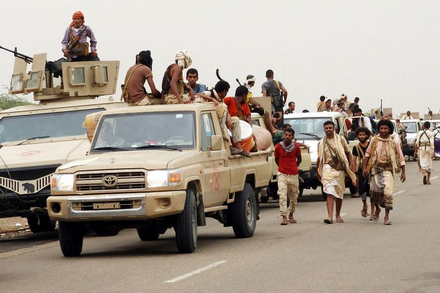 Yemeni government forces and vehicles take position as they fight Houthi rebels in Hodeidah.