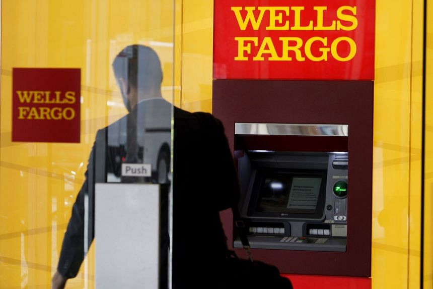 A man walks by an ATM at the Wells Fargo & Co bank in downtown Denver, US.