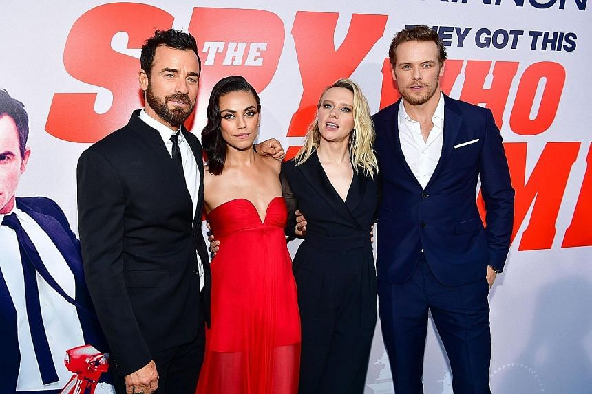 Stars of The Spy Who Dumped Me - (from far left) Justin Theroux, Mila Kunis, Kate McKinnon and Sam Heughan - at the movie's premiere in Los Angeles.