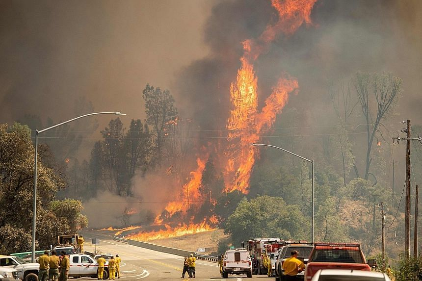 The Carr Fire raging near Whiskeytown in California last Friday. The state has also seen power shortages as record heat resulted in a surge in demand for air-conditioners.