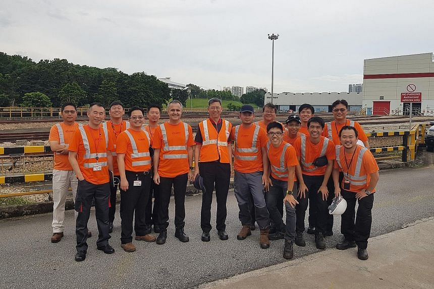 Mr Neo Kian Hong (centre), who took over as chief executive of SMRT yesterday, with engineers from the Permanent Way team, which looks after track and trackside infrastructure, at Bishan Depot during a familiarisation visit in May.