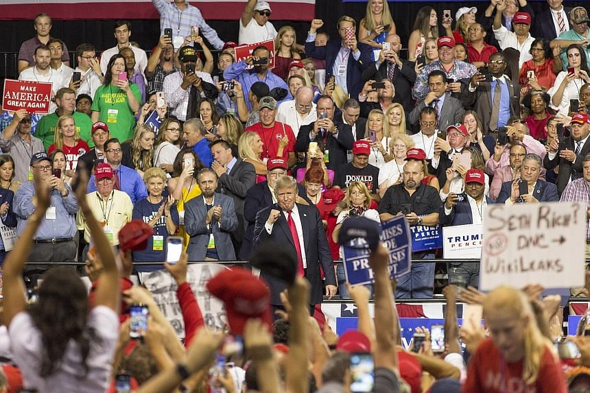 US President Donald Trump at a rally in Tampa, Florida, on Tuesday, drumming up support for his agenda and Republican candidates in the midterm elections in November. Members of Congress who had been briefed by Facebook on the new coordinated politic