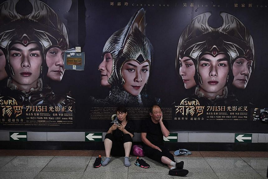Posters for the movie Asura at a Beijing subway station. Costing more than US$110 million, Asura was the most expensive film wholly made by a Chinese studio. But it was pulled after earning just over US$7 million in its opening weekend - a move the f