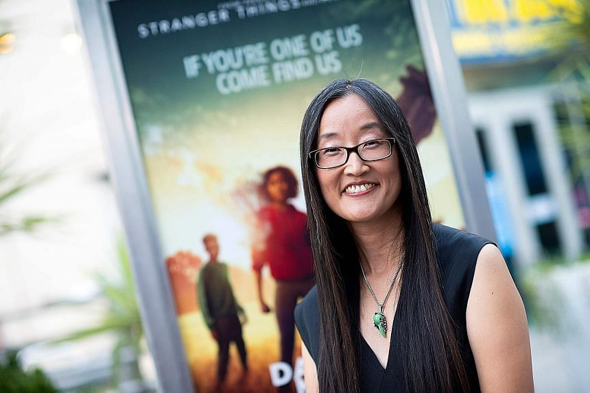 Director Jennifer Yuh Nelson, who says she always had someone take a chance on her, hired ethnically diverse actors to lead The Darkest Minds (above).
