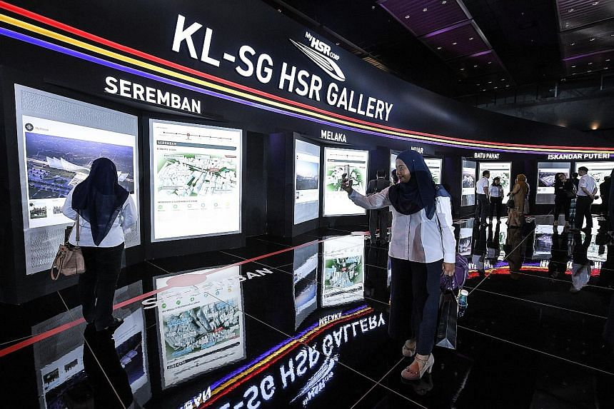 Visitors at an exhibition last year on the KL-Singapore High-Speed Rail. Malaysia's Economic Affairs Minister Mohamed Azmin Ali was quoted in Malaysian media online as saying that the meeting with Singapore will hopefully take place early this month.