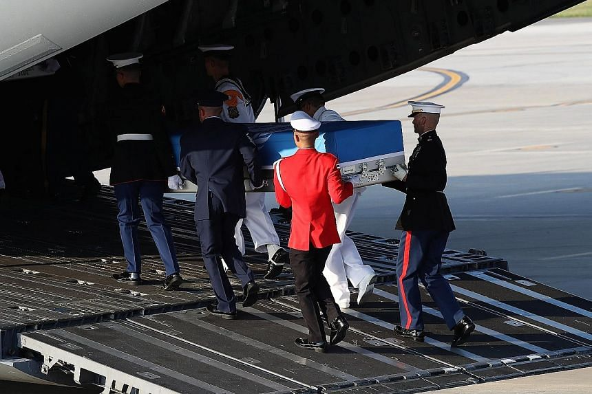 A ceremony at Osan Air Base in Pyeongtaek, South Korea, yesterday to mark the return of the remains of US soldiers. The return marks a partial fulfilment of an agreement reached between the US and North Korea. .