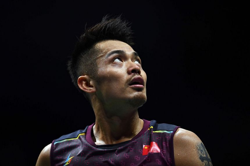 China's Lin Dan reacts after a point against Shi Yuqi of China.