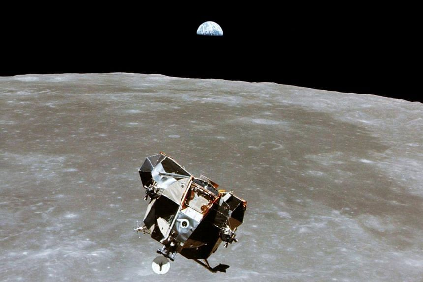 The Apollo 11 Lunar Module ascent stage, with astronauts Neil Armstrong and Edwin Aldrin Jr aboard, is photographed from the Command and Service Modules in lunar orbit in this July 1969 file photo.