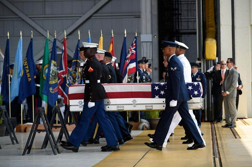Military pallbearers carrying what's believed to be remains of US service members collected in North Korea in Honolulu, Hawaii, on Aug 1, 2018.