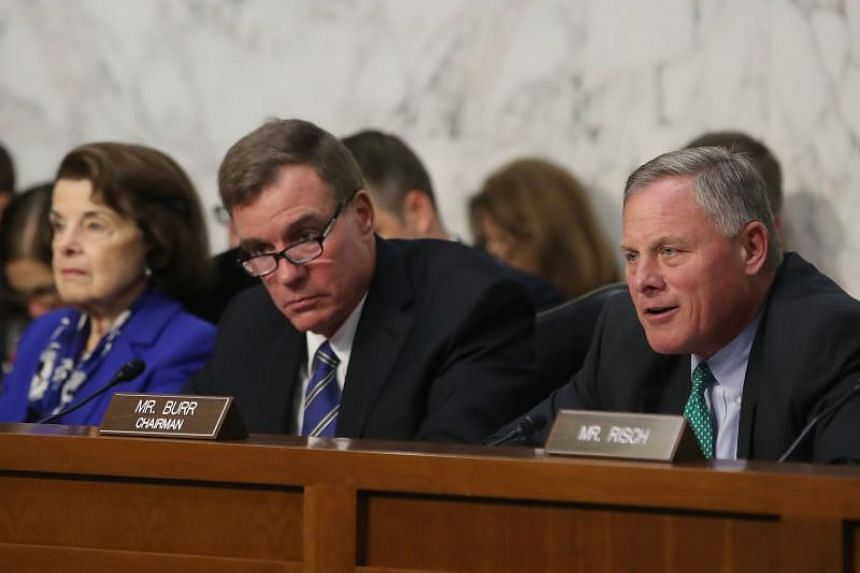 Chairman Richard Burr (right) speaks while flanked by ranking member Senator Mark Warner (centre), and Senator Dianne Feinstein during a Senate Intelligence Committee hearing, on Capitol Hill, in Washington, DC, on Aug 1, 2018.