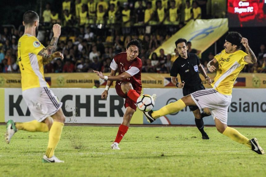 Home United's Shahril Ishak (in red) setting up the equaliser.