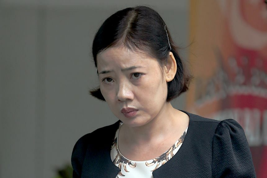 Manicurist Tran Thi Thuy Hang, 38, bludgeoned to death her stepdaughter's parrot Lucky after the bird pecked her face.
