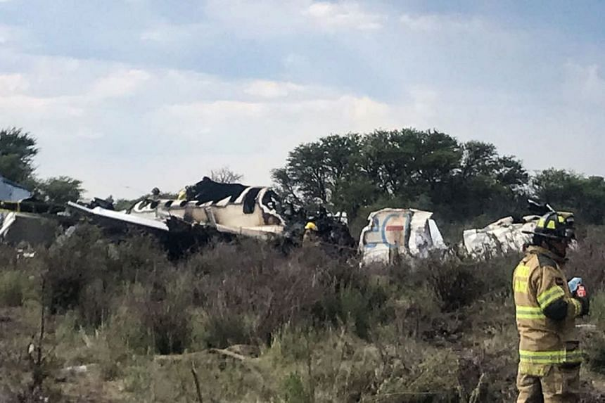 All 103 passengers and crew survived when this Embraer 190 passenger jet (above) smashed into scrubland.