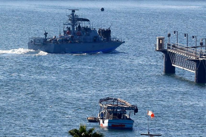 Israeli navy ships manoeuvre at the military port of Ashdod, southern Israel, on July 29, 2018.