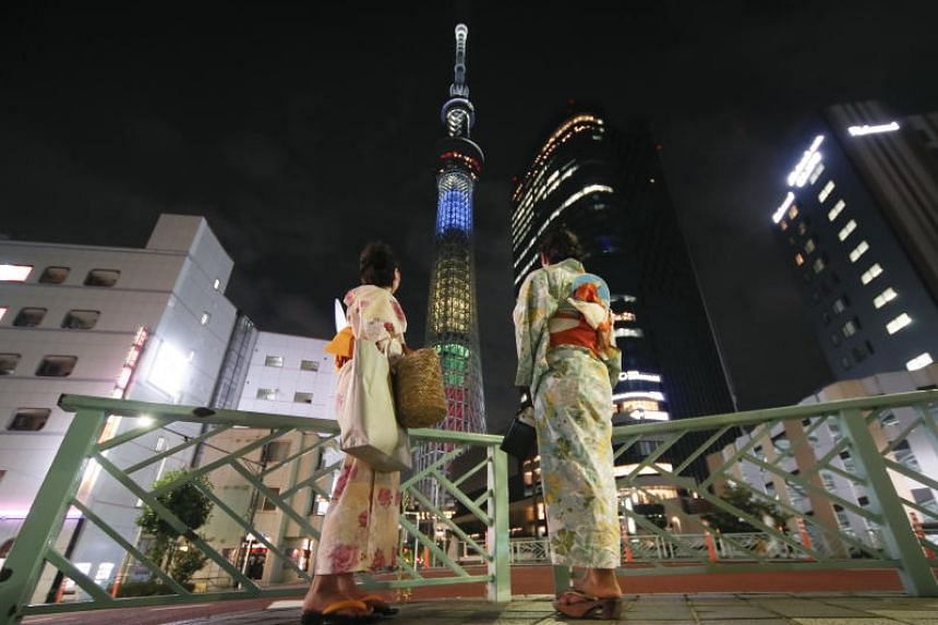The Tokyo Skytree, is illuminated in the colors of the Olympic Ring, after the countdown ceremony of Two Years to go the Tokyo 2020 Olympic Games, in Tokyo, Japan, on July 24, 2018.
