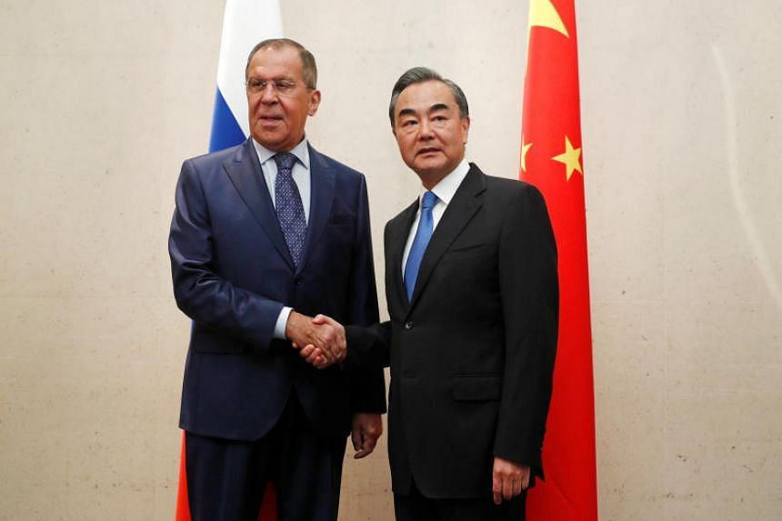 Russia's Foreign Minister Sergei Lavrov meets with China's Foreign Minister Wang Yi on the sidelines of the Asean Foreign Ministers' Meeting in Singapore, on Aug 2, 2018.