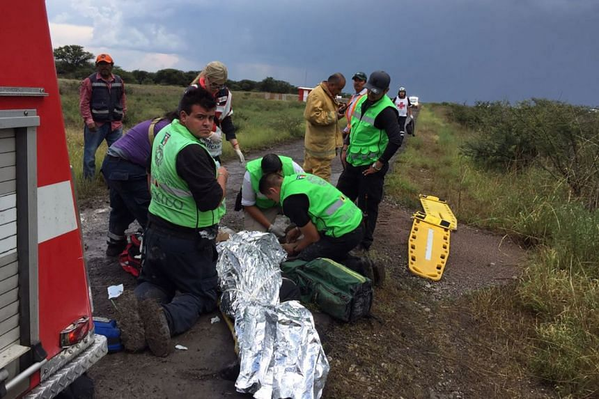 Emergency personnel helping passengers at the site of the crash on July 31, 2018.