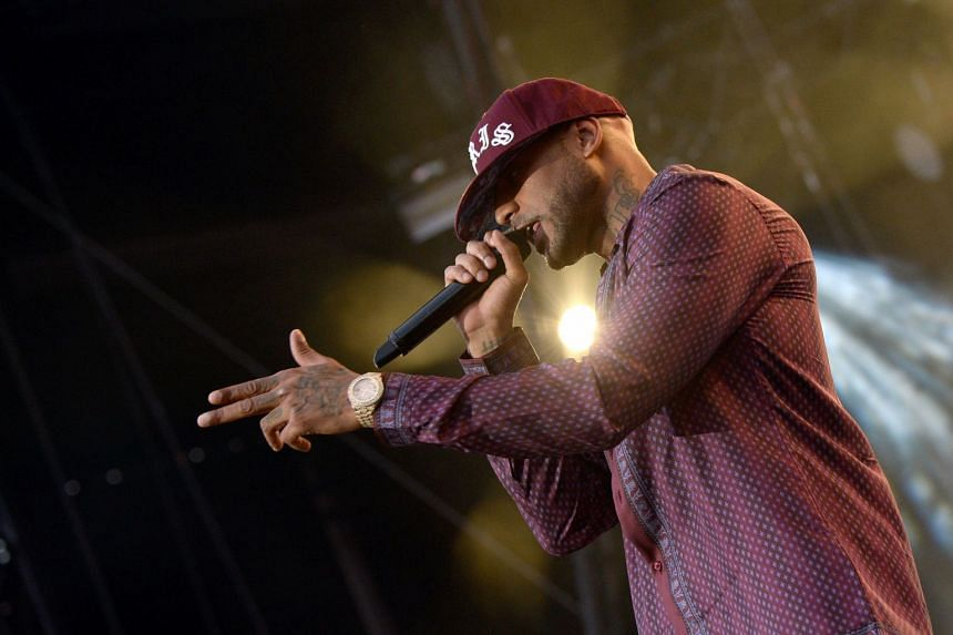 French rapper Booba performs at a festival in Belfort, France.
