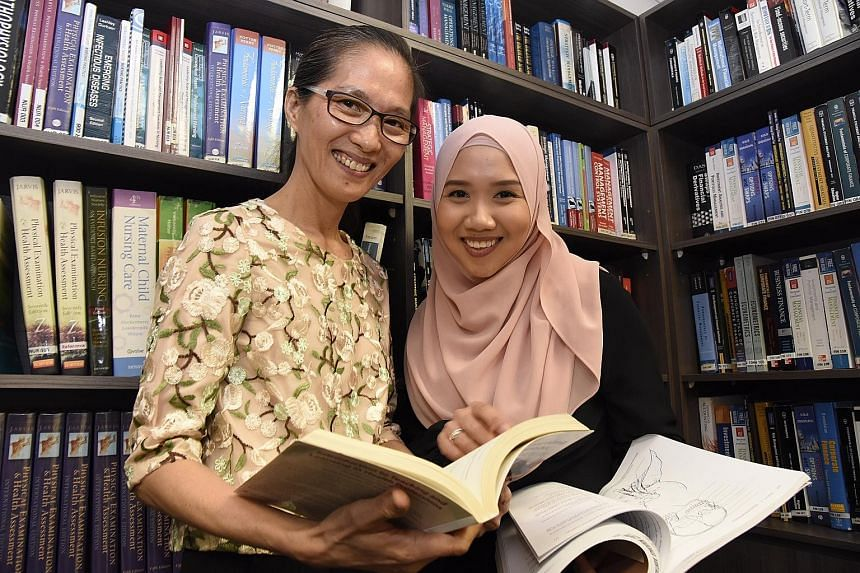 Madam Liaw Lay Kian (far left) and Ms Nurulhuda Abdul Majid are scholarship recipients of Ngee Ann Academy, which is offering the first King's College London part-time nursing degree outside the United Kingdom.