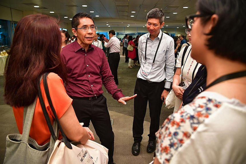The South East Community Development Council (CDC) has set up a $200,000 grant to encourage more ground-up community projects. South East District Mayor Maliki Osman (in purple) announced the new grant at the CDC's annual conference held at the NTUC
