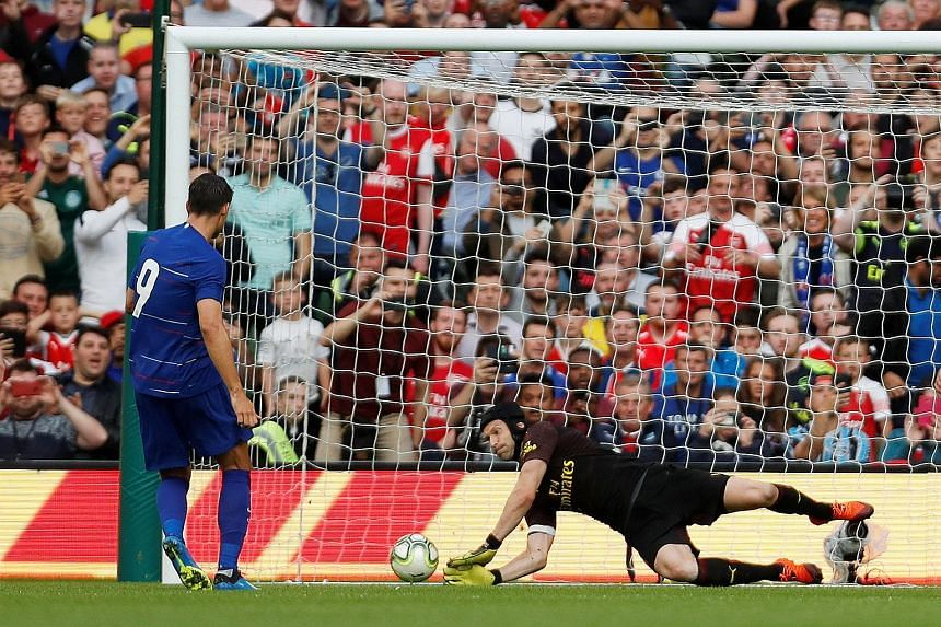 Arsenal goalie Petr Cech saving a penalty from Chelsea's Alvaro Morata during their friendly in Ireland on Wednesday. The Blues conceded in second-half stoppage time to draw 1-1, before losing 6-5 on penalties.
