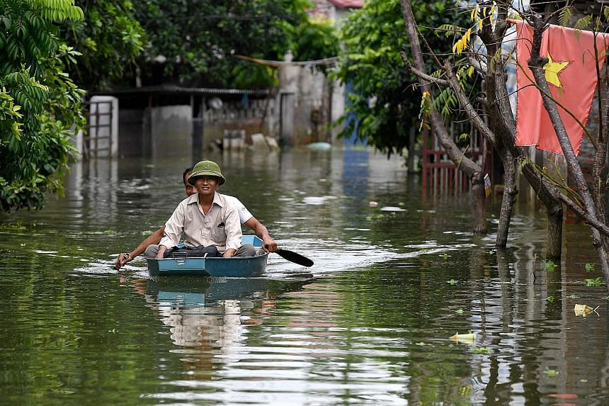 Streets in Hanoi's suburban Chuong My district have been turned into waterways after heavy rain over the past 10 days flooded the area. Reports say that more than 6,000 people have been evacuated from the area, with more evacuations possible in the c